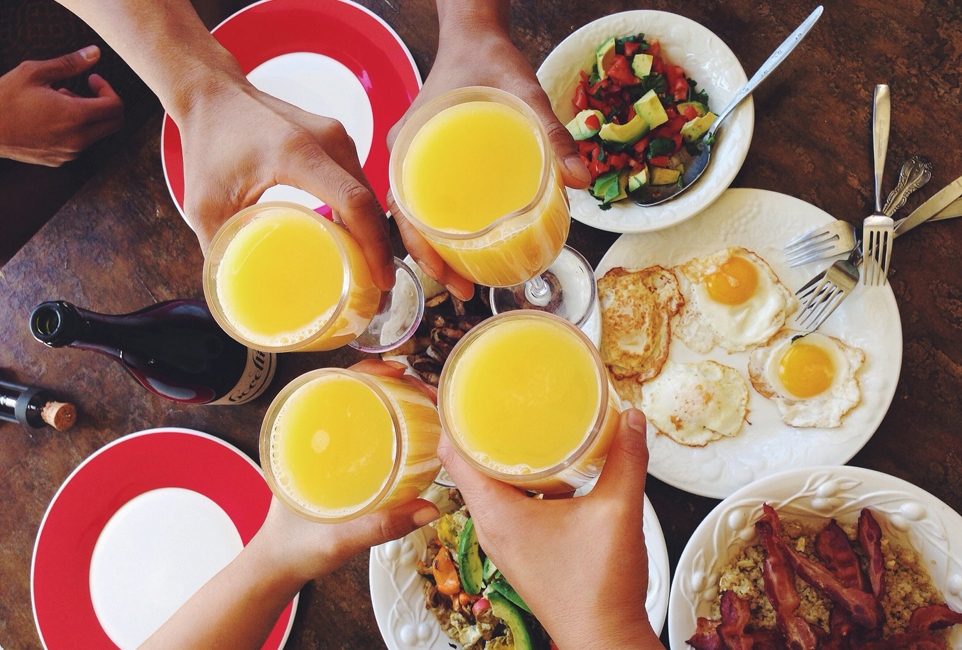 Brunch toasting mimosas
